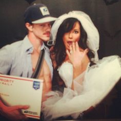 """The newlyweds, who tied the knot in a secret wedding in July, got cheeky in their """"mail-order"""" bride and mailman outfits."""