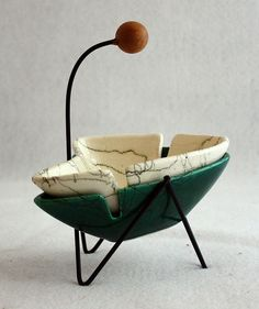 There is just something about these vintage mid century  boomerang ashtrays i find so attractive. http://www.flickr.com/photos/tinkersmoon/4300970015/#