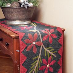 The muted colors and soft felted wool make this folksy table runner a holiday favorite.