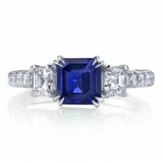 Sapphire and Diamond 3-Stone Ring by Omi Prive. We love the emerald cut center stone!