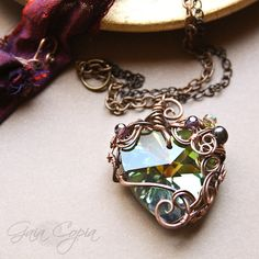 Rainbow Glass Faceted Heart with Organic Wire Wrapping made by Gaia Copia.