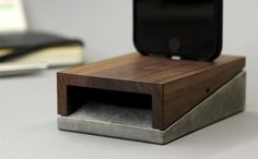 Meet mobi - the most adaptable iPhone dock youve ever seen  WoodUp mobi combines the roughness of concrete and the elegance of wood. The result is