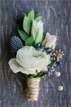 white and blue green boutonniere