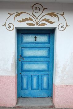 love the stenciling above the door and the cheerful blue