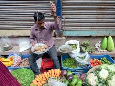 A vegetable monger plies his trade on Hindu Street (Shankhari Bazar Road) in old Dhaka, Bangladesh. Gypsum Decoration, Gypsum Wall, Dhaka Bangladesh, Ceiling Rose, Outdoor Furniture Sets, Outdoor Decor, Table Decorations, Vegetables, Street