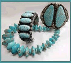 Lone Mountain Turquoise Necklace, Bruce Eckhardt. On the left, No 8 Turquoise cuff by Delbert Gordon, and on the right, No 8 cuff Calvin Martinez