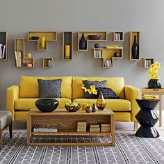 yellow interior design gray wall yellow sofa wooden coffee table black side table