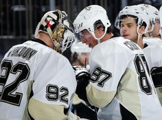 Crosby gives Vokoun a celebratory head tap after Vokoun's shutout against the Rangers 1/31/13