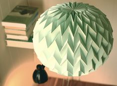 These beautiful lampshades are 100% handmade (and folded) from 60% cotton paper that's produced in a 450-year-old paper mill in Annonay, France.