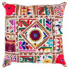 "Bring a pop of style to your sofa or favorite reading nook with this eye-catching pillow, featuring an exotic patchwork-inspired motif for bohemian-chic appeal.  Product: PillowConstruction Material: Cotton and polyester coverColor: MultiFeatures:  Patchwork-inspired motifLace accentsMade in India Insert includedDimensions: 22"" x 22""Cleaning and Care: With a dry cotton towel or white paper towel, blot out stain as much as possible. Scrape off any debris. Test fabric cleaner in discreet ..."
