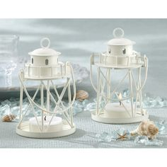 Features:  -Cream-hued, sturdy metal in a lighthouse design with handle and a…