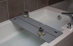 Bathboard/ caddy with 2 wine glass holders. Perfect for a cozy relaxing bath with your lover, husband, or wife. Tea Light Candles, Tea Lights, Wood Bath, Bath Tub, Bath Board, Wine Glass Holder, Relaxing Bath, Electronic Devices, Bath Caddy