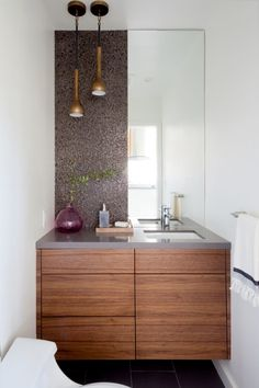LANEY LA redesigned a single family home for a couple with the desire to preserve a mid-century residence in Los Angeles' Silverlake neighborhood. Bathroom Layout, Modern Bathroom Design, Modern Interior Design, Bathroom Interior, Small Bathroom, Modern Decor, Bathroom Cabinets, Bathroom Faucets, Bathroom Ideas