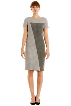 Hand woven black and white dress with textured geometric pattern in 100% cotton. Fully lined with front and rear contrast panels. Short sleeves and invisible back zip. Length 97cm. *Please Note: This dress is designed to be fitted so we would recommend sizing up if you would prefer a looser fit.