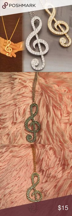 """Trouble Clef Necklace Cute necklace that is perfect for someone who loves music! Could be for someone in a band, choir, or just someone who enjoys music. Chain is 28"""". Listing is for one necklace. You choose either gold or silver. New in package. Jewelry Necklaces"""