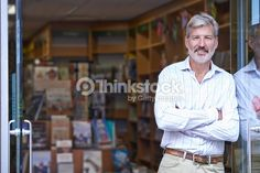 Stock Photo : Portrait Of Male Bookshop Owner Outside Store