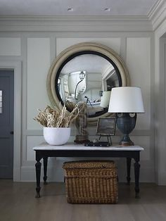 Convex mirror and black table with marble top