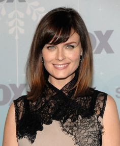 Front Side swept bangs:  You thought only side bangs look good? You can rock with Front bangs. Do some soft and wispy front bangs which you can side sweep for a different show altogether. This is among the latest haircuts for medium hair. emily deschanel 2011