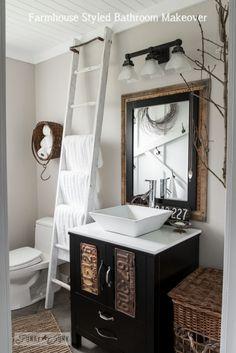 Salvaged farmhouse bathroom makeover with ladder towel holder via http://www.funkyjunkinteriors.net/