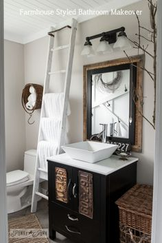 Salvaged farmhouse bathroom makeover with ladder towel holder via http://www.funkyjunkinteriors.net/