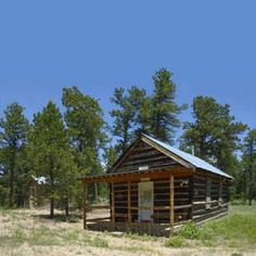 Angle view of the Bunce school, outhouse included, a historic site at Bunce School Road behind the Kelly House on Highway #7, recently restored by the Hilltop Guild, Allenspark, Colorado, south of Estes and Rocky Mountain National Park.