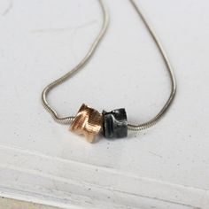 Image of In Motion Black and Gold Necklace