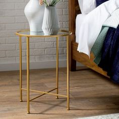 Simplistic, yet stylish, this end table is the perfect accent for your living room sofa or bedside ensemble. Founded atop four straight legs connected by a cross support, its frame is crafted from iron Living Room Furniture, Living Room Decor, Table Furniture, Round End Tables, Small Accent Tables, Home Furniture Online, End Tables With Storage, Diy Bedroom Decor, Home Decor