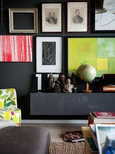 Brighten a wall using colorful accents and personalizing with paintings, pictures and framing