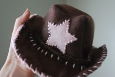 If anyone is interested in knowing how to make the cowboy hat I made for Samuel here is the link to make one.