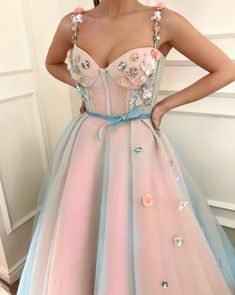 I'd rearrange some of those embellishments. Predictable patterns kill some really cute pieces for me. But that sheer blue over the baby pink, precious af.