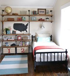 Industrial shelves from beneathmyheart.net (Love this storage idea for a room with no closet. But place a hanging rod or two where the bed is.)
