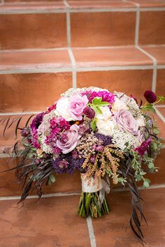 Soft florals and textured botanical elements combined in this romantic plum and cream bridal bouquet for a Santa  Barbara wedding. Photo by Kelsey Crews