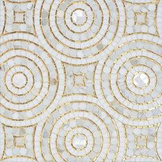 Orson tile, a hand-cut mosaic with Calacatta marble and 24K-gold glass