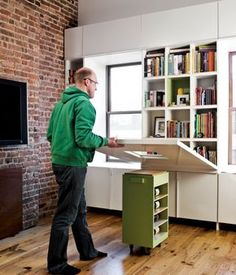 Important Design Truths Every Renter Should Remember bookshelves hidden by a fold-down table!bookshelves hidden by a fold-down table! Tiny Spaces, Small Apartments, Ikea Small Spaces, Luxury Apartments, Fold Down Table, Drop Down Table, Compact Living, Small Space Living, Tiny Living