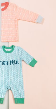Cool in blue, the Mon Petit Baby Grow is made from the softest of cotton and has an all-over geometric print with contrasting green cuffs and popper leg openings.