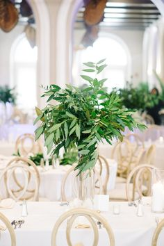 Tall simple greenery arrangements are all you need for a nice clean crisp wedding feel.  Coordination | Mac & B Events >> Photography | Aaron and Jillian Photography >> Florist | Tiger Lily Florist