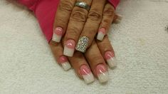 Pink and white sculptured nail with treasure nail