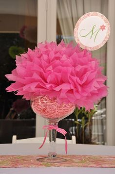 A fun and flirty party centerpiece idea for parties--drop a tissue pouf into an oversized glass with a little paper shred, add a personalize paper circle and you'll have a fabulous focal point!