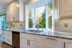 Luxury home interior boasts amazing white kitchen with custom white shaker cabinets topped with granite fitted White Kitchen Backsplash, Small Kitchen Cabinets, Refacing Kitchen Cabinets, White Kitchen Decor, Kitchen Cabinet Colors, Farmhouse Kitchen Decor, Kitchen Layout, Kitchen Design, Shaker Cabinets