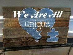 We are all unique autism sign