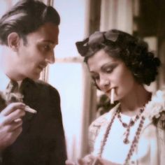 Here's Salvador Dali having a smoke with Coco Chanel in the 1930s.