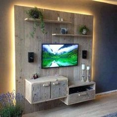 Media cabinet is not just a sleek little TV trolley but a necessity to organize your media gadgets in a nice and thrifty manner. But, why to spend hundreds and thousands on purchasing media cabinets when you can build this amazing pallet wood media wall with shelves, cabinets and drawers. Its rustic and simply awesome.