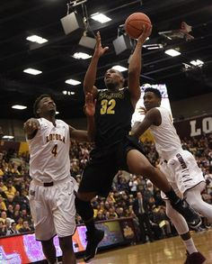 Wichita State guard Tekele Cotton (32) is defended by Loyola of Chicago guard Devon Turk (4) during the first half of an NCAA basketball game in Chicago, Saturday, Jan. 11, 2015.  (AP Photo/David Banks)