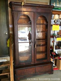 Using salvaged and repurposed materials for the kitchen remodel in our old Victorian house! This antique glass front bookcase is going to double as cabinetry and a pantry! See the entire kitchen project… we are repurposing some really beautiful furniture!