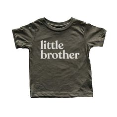 """""""Little Brother"""". Share sibling pride in style! This sweet kids shirt features trendy typography in white ink on super soft tri-blend olive fabric. Product Details: """"Little Brother"""" graphic tee Designed with love and printed by hand Available in """"Big Brother"""" About The Oyster's Pearl: Emily and Brad Weckesser are the husband-and-wife design duo behind The Oyster's Pearl. Located in Northeastern Ohio, they collaborate together daily on branding projects, stationery and print design… Tee Design, Print Design, Graphic Shirts, Graphic Sweatshirt, Brick Studio, Big Brother Tshirt, Kids Shirts, T Shirts For Women, White Ink"""
