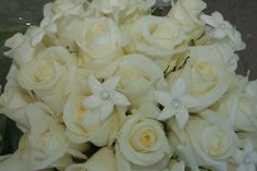 White wedding stephanotis with a pearl center surrounded with close white roses