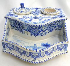 Antique Blue & White Porcelain Inkwell Finely detailed hand-painted cobalt blue and white porcelain inkwell. The body of the inkwell is a hexagonal shape with four feet.