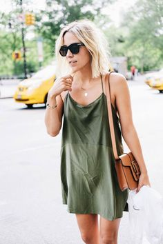 """There are a lot of new trends for spring 2016, and many of them a throwback to the '70s, '90s, or even the early 2000s – and the slip dress is no exception. The slip dress, which is slinky and sexy, is reminiscent of '90s fashion, especially when layered over a shirt or turtleneck. As glamorous as they are, slip dresses tend to look almost exactly like lingerie, which is why a lot of people say silly things like, """"Oh, I could never pull that off."""""""