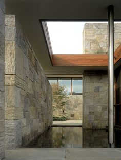 Love this stone house design with the water feature sneaking into it. Classic.