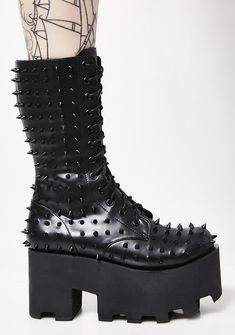 Charla Tedrick Black Metal Boots cuz you trying to hear that bass drop. Shuffle around with these vegan leather platform boots that have tonal spike details all ova, rubber platforms and lace-up closures.